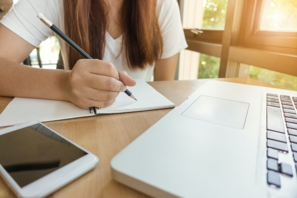 woman studying with laptop